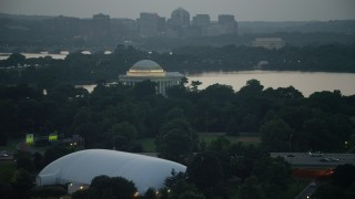 AX76_178 - 5K stock footage aerial video approaching the Jefferson Memorial beside Tidal Basin, Washington, D.C., twilight