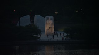 AX76_185 - 5K stock footage aerial video of Martin Luther King Jr. National Memorial lit up for the night, Washington, D.C., twilight