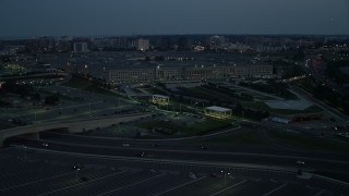 AX76_186 - 5K stock footage aerial video approaching The Pentagon in Washington, D.C., night