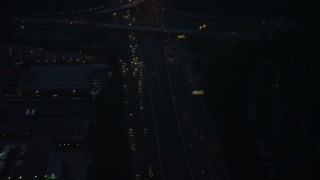 AX76_191 - 5K stock footage aerial video of heavy traffic on Interstate 495, Springfield, Virginia, night