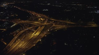 AX77_001 - 5K stock footage aerial video approaching Interstate 495 and 395 interchange, Springfield, Virginia, night