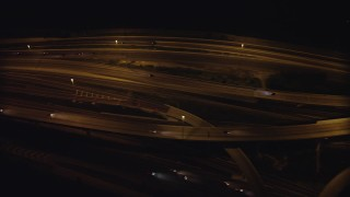 AX77_003 - 5K stock footage aerial video of a bird's eye view of light traffic on Interstate 95, Alexandria, Virginia, night