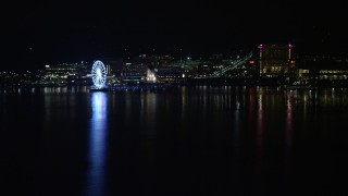 AX77_011 - 5K stock footage aerial video of Capitol Wheel and Gaylord National Resort and Convention Center, National Harbor, Maryland, night