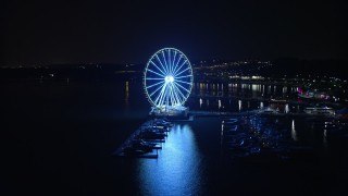 AX77_015 - 5K stock footage aerial video of the Capitol Wheel and marina, reveal Gaylord National Resort & Convention Center, National Harbor, Maryland, night