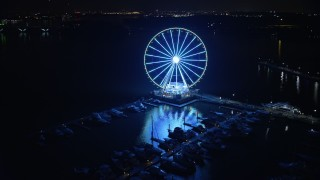 AX77_018 - 5K stock footage aerial video of the Capitol Wheel and the National Harbor Marina, Maryland, night