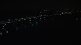 AX77_020 - 5K stock footage aerial video of light traffic on Woodrow Wilson Memorial Bridge over the Potomac River, Fort Washington, Maryland, night