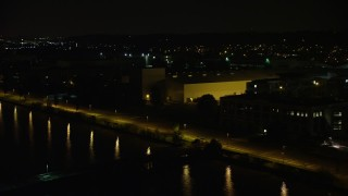 AX77_021 - 5K stock footage aerial video flying by the United States Naval Research Laboratory by the Potomac River, Washington, D.C., night