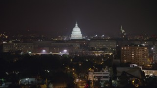 AX77_022 - 5K stock footage aerial video of the United States Capitol in Washington, D.C., night