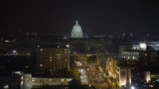 AX77_022E - 5K stock footage aerial video of the United States Capitol in Washington, D.C., night