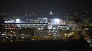 AX77_024 - 5K stock footage aerial video of Nationals Park and United States Capitol, Washington, D.C., night