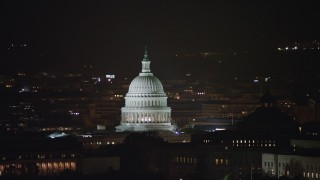 AX77_031 - 5K stock footage aerial video flying by the United States Capitol, Washington, D.C., night