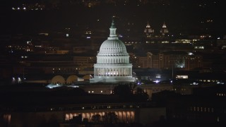AX77_032 - 5K stock footage aerial video of the United States Capitol building dome in Washington, D.C., night