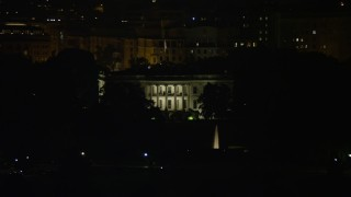 AX77_040 - 5K stock footage aerial video of The White House, eclipsed by Washington Monument, Washington, D.C., night