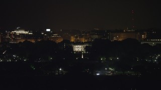 AX77_043 - 5K stock footage aerial video of The White House and South Lawn Fountain in Washington, D.C., night