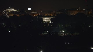 AX77_044 - 5K stock footage aerial video of The White House and the South Lawn Fountain in Washington, D.C., night