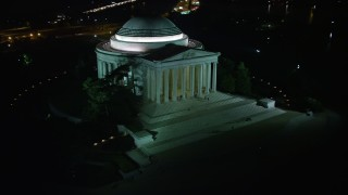AX77_045 - 5K stock footage aerial video of the Jefferson Memorial with visitors in Washington, D.C., night