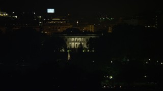 AX77_047E - 5K stock footage aerial video of The White House seen from the base of the Washington Monument, Washington, D.C., night