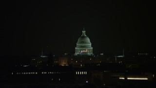 AX77_054 - 5K stock footage aerial video of the United States Capitol building in Washington, D.C., night