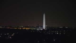 AX77_057 - 5K stock footage aerial video of the Washington Monument, reveal Capitol Building, Washington, D.C., night