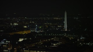 AX77_064 - 5K stock footage aerial video of the White House and the Washington Monument, reveal Jefferson Memorial in Washington, D.C., night