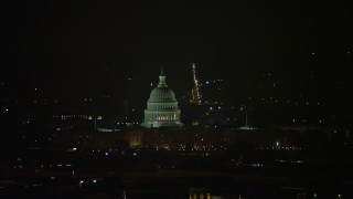 AX77_067 - 5K stock footage aerial video of the United States Capitol building in Washington, D.C., night