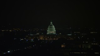 AX77_071 - 5K stock footage aerial video of the United States Capitol Building and dome in Washington, D.C., night