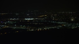AX77_072 - 5K stock footage aerial video of the Pentagon in Washington, D.C., at night