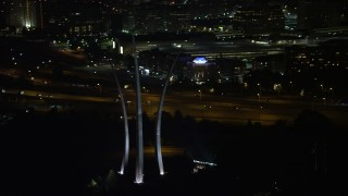 AX77_073 - 5K stock footage aerial video flying by United States Air Force Memorial, Arlington National Cemetery, Arlington, Virginia, night
