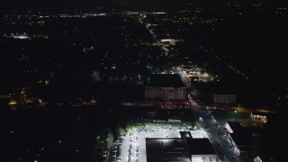 AX77_075 - 5K stock footage aerial video flying over suburban homes near Columbia Pike in Arlington, Virginia, night