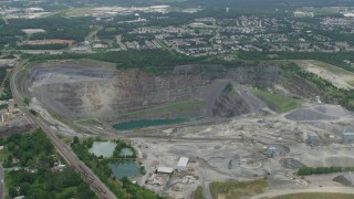 AX78_005 - 5K stock footage aerial video approaching Vulcan Lake at the bottom of a quarry in Manassas, Virginia