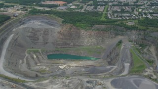 AX78_006 - 5K stock footage aerial video of Vulcan Lake in a deep quarry in Manassas, Virginia