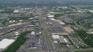 AX78_008 - 5K stock footage aerial video of strip malls and shopping centers by Sudley Manor Drive in Manassas, Virginia