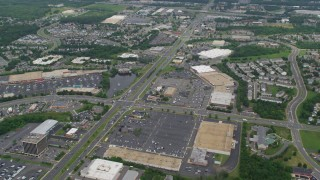 AX78_009 - 5K stock footage aerial video of strip malls and shopping centers around busy intersection in Manassas, Virginia