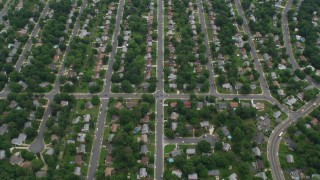 AX78_010 - 5K stock footage aerial video of suburban streets and neighborhoods with trees, Manassas, Virginia
