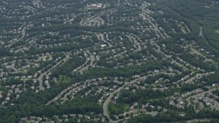 AX78_015 - 5K stock footage aerial video of suburban homes on curved streets in Clifton, Virginia