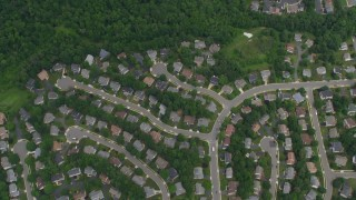 AX78_019 - 5K stock footage aerial video of a bird's eye view of suburban homes, apartment buildings, Clifton, Virginia