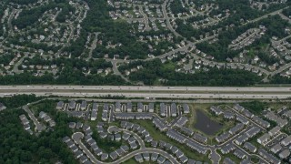 AX78_020 - 5K stock footage aerial video of a bird's eye view of light traffic on Interstate 66 between suburban homes and apartment complexes in Centreville, Virginia