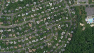 AX78_021 - 5K stock footage aerial video of a bird's eye view of suburban neighborhoods, Greenbriar East Elementary School, Fairfax, Virginia