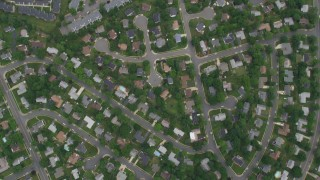 AX78_022 - 5K stock footage aerial video of a bird's eye view of suburban neighborhoods, apartment buildings, Highway 50, Fairfax, Virginia