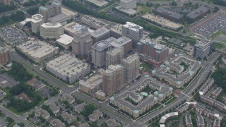 AX78_032 - 5K stock footage aerial video flying away from Reston Town Center in Reston, Virginia