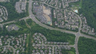 AX78_039 - 5K stock footage aerial video of a reverse view of Great Falls Plaza and tract homes in Sterling, Virginia