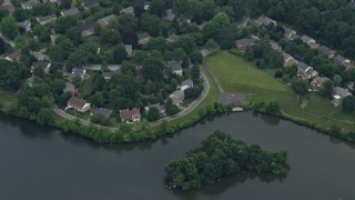 AX78_044 - 5K stock footage aerial video of waterfront homes on Lake Whetstone in Gaithersburg, Maryland