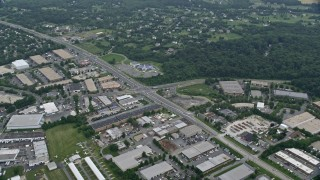 AX78_046 - 5K stock footage aerial video of Inter-Denominational Church and stores Woodfield Road, Gaithersburg, Maryland