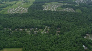 AX78_047 - 5K stock footage aerial video tilting from bird's eye view of neighborhoods in Rockville, Maryland
