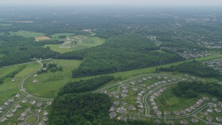 AX78_048 - 5K stock footage aerial video flying over suburban neighborhoods to approach OBGC Community Park in Olney, Maryland
