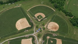 AX78_049 - 5K stock footage aerial video approaching baseball fields at OBGC Community Park in Olney, Maryland