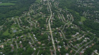 AX78_050 - 5K stock footage aerial video flying over suburban neighborhoods in Olney, Maryland