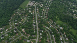 AX78_051 - 5K stock footage aerial video flying over suburban neighborhoods and Belmont Elementary School in Olney, Maryland
