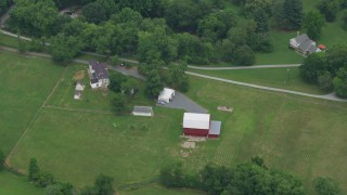 AX78_053 - 5K stock footage aerial video of a red barn and rural house in Brookeville, Maryland