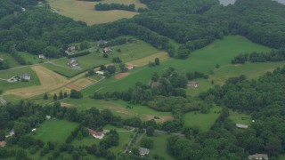 AX78_055 - 5K stock footage aerial video of rural homes in Brookeville, Maryland